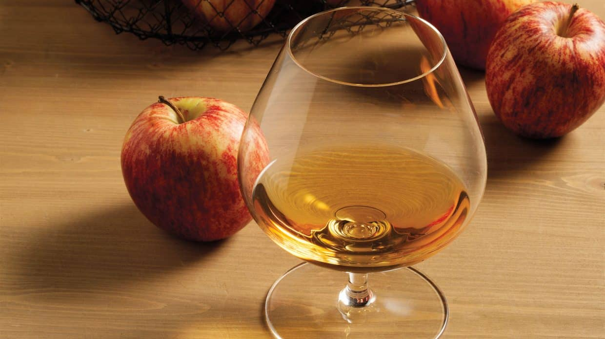 Whisky tasting glass near to an apple