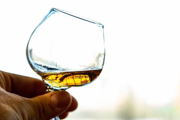 Tiny glass with whisky for tastings