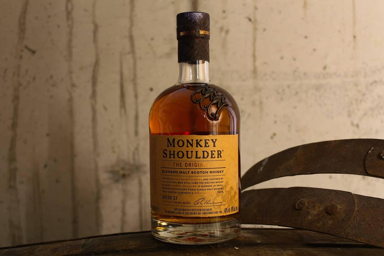 Bottle of Monkey Shoulder on top of an oak barrel
