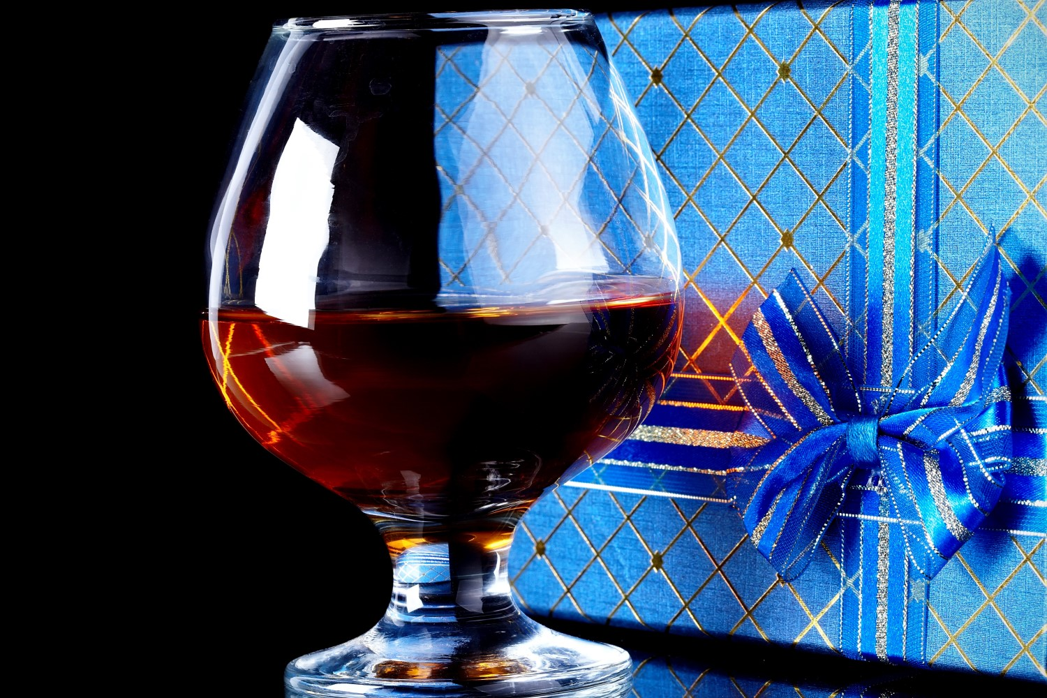 glass of whisky and a gift behind it