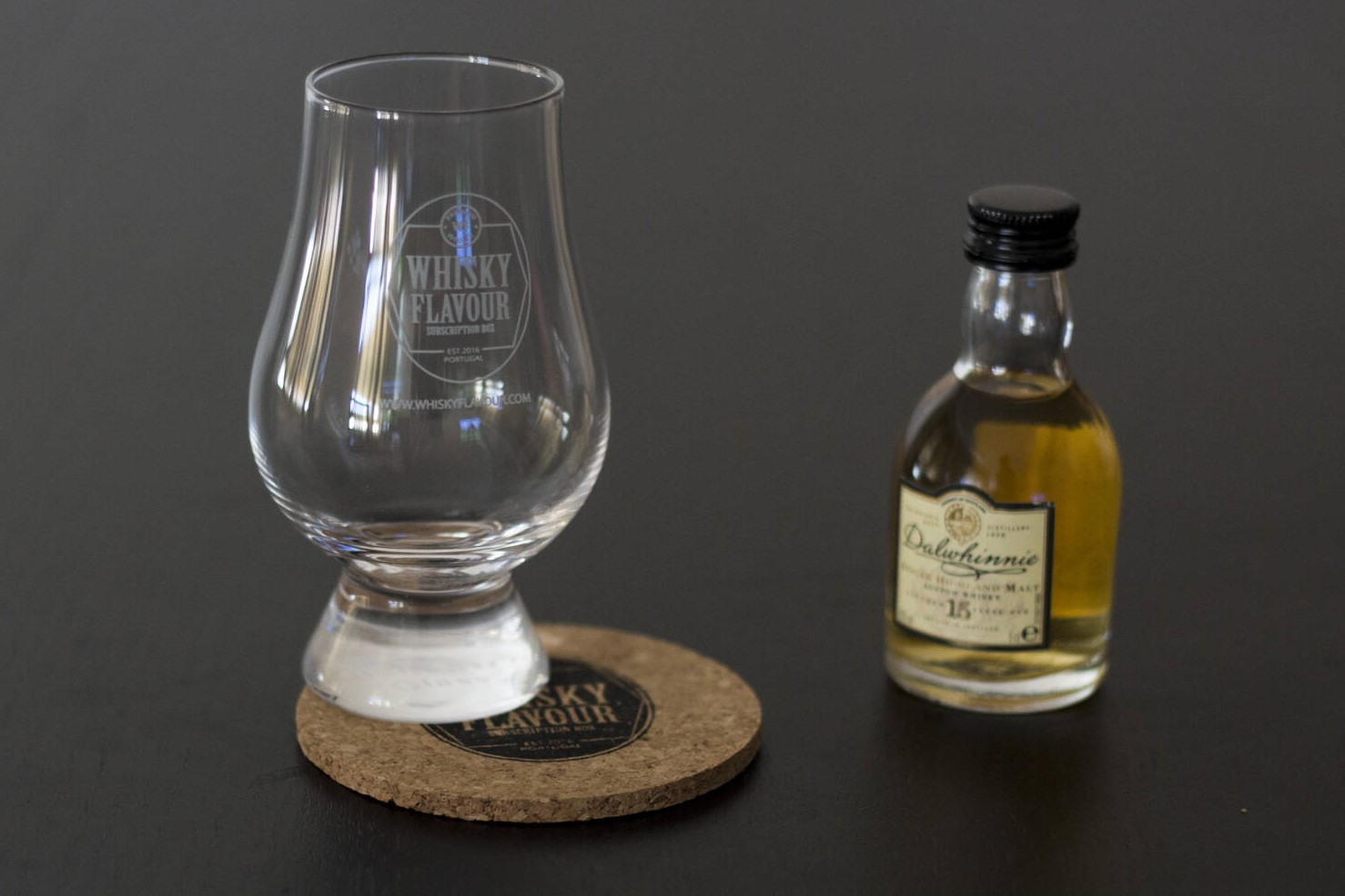 Glencairn glass with a whisky miniature from our whisky subscription