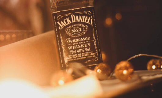Bottle of jack daniel's whiskey surrounded by lights