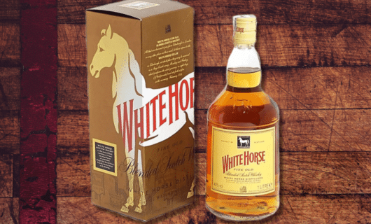 Bottle of white horse scotch in a wooden background