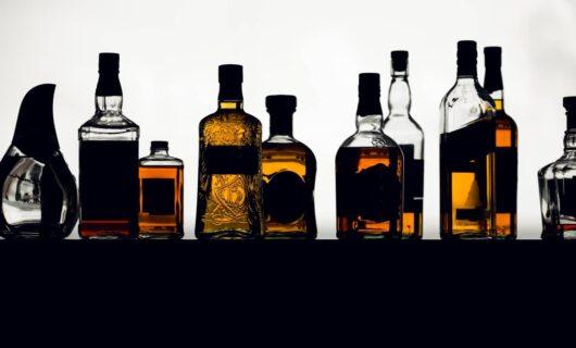 aligned single malt whisky bottles against the light