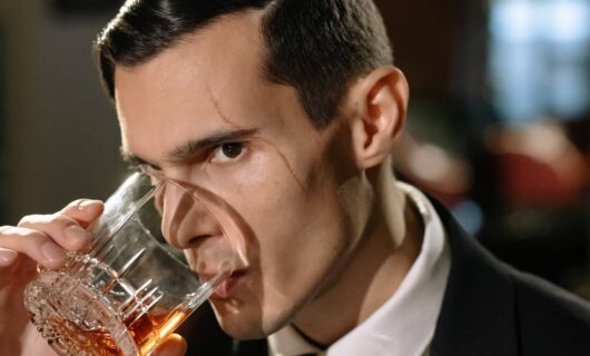 Man sniffing a whisky expression